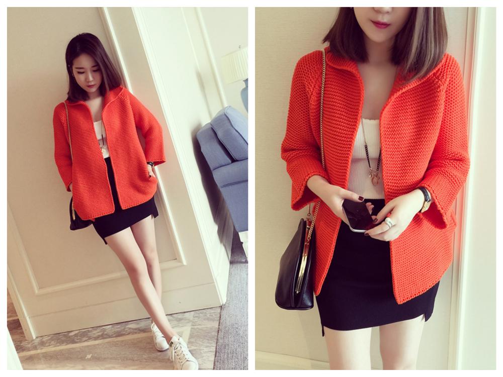 オレンジ色の服